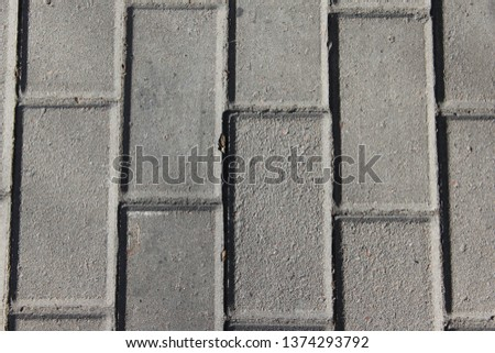 the texture of the grey paving slabs background #1374293792