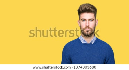 Young handsome bussines man Relaxed with serious expression on face. Simple and natural looking at the camera. #1374303680