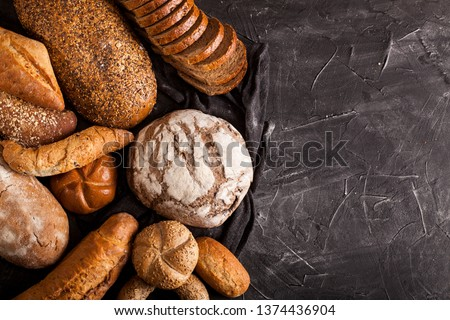 Assortment of baked goods on dark table with free copy space for text. Top view, from above, flat lay. #1374436904