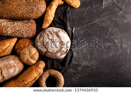 Assortment of baked goods on dark table with free copy space for text. Top view, from above, flat lay. #1374436910