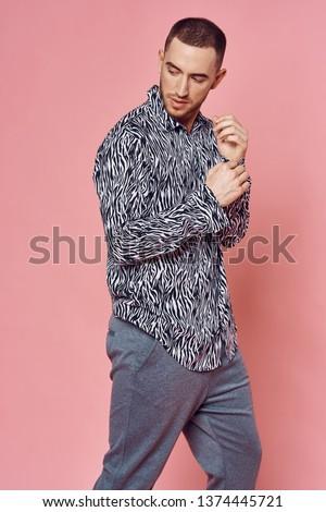 Cute man in a zebra shirt model looks pink background