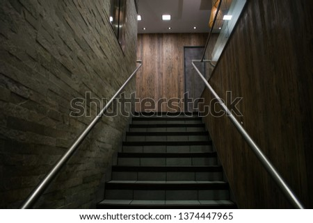 Stairs leading up to the next level in an apartment  #1374447965