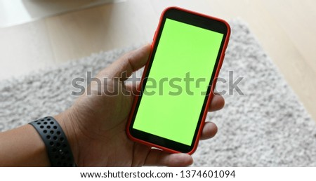 Use of mobile phone with green screen