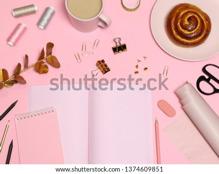 Pink work table with notes paper, office accessories, coffee, baking #1374609851