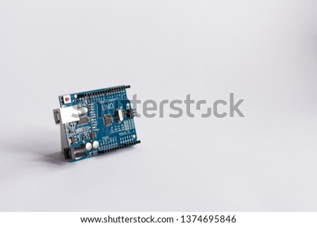 TERNOPIL/UKRAINE - APRIL 19, 2019: Arduino Uno. Micro controller. Technology. Electronic computing machine. High intelligence. science. White background. STEM, robotics. DIY. AI. Development platform #1374695846