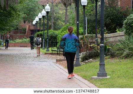 Gainesville, FL United States- 04/15/2019: College students walk across the campus of the University of Florida.  #1374748817