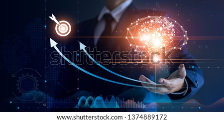Businessman holding abstract brain and icon digital marketing, strategy and growtn investment business target goal, media and technology.