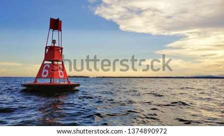 Sunset with Ocean Buoy. Great Image of Sea Background Royalty-Free Stock Photo #1374890972