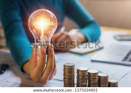 hand holding light bulb. idea concept with innovation and inspiration #1375034801