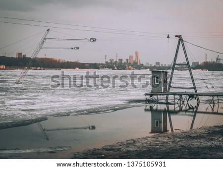 jetty overlooking the icy river #1375105931