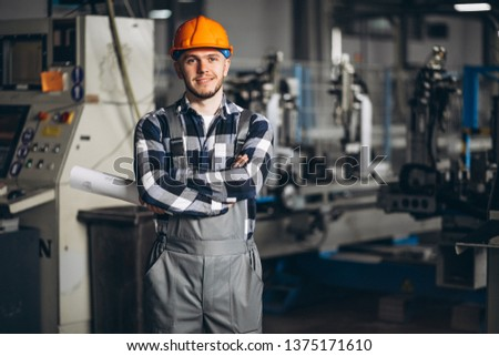 Male worker at a factory #1375171610