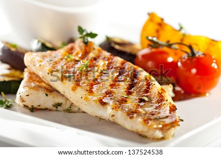 Grilled Fish Fillet with BBQ Vegetables Royalty-Free Stock Photo #137524538