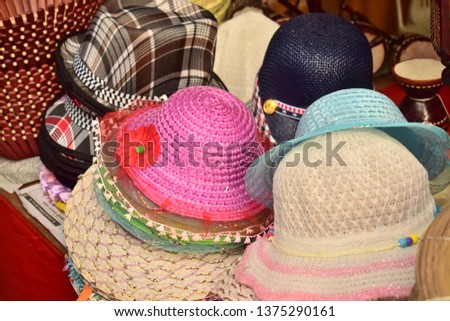 new market,Dhaka/Bangladesh - April 18,2019:Ladies colorful hats with beautiful design #1375290161