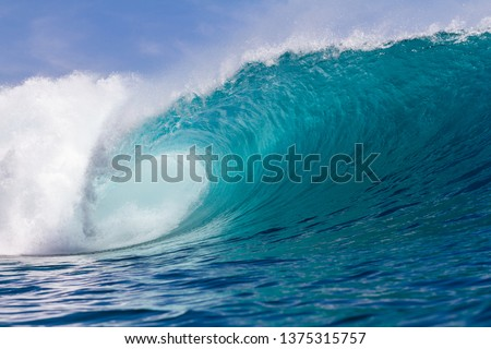 perfect wave breaking in Indonesia on a shallow reef #1375315757