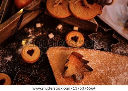 Christmas decoration. Christmas cooking. Dough, flour, cookies, tangerines, cup, mug, marshmallow, christmas ligths. #1375376564