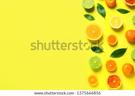 Different citrus fruits and leaves on color background, flat lay. Space for text #1375666856