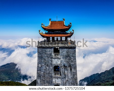 """Fansipan mountain; the highest mountain in the Indochinese Peninsula (comprising Vietnam, Laos, and Cambodia), hence its nickname """"the Roof of Indochina"""". Lao Cai, Vietnam. Royalty-Free Stock Photo #1375725104"""