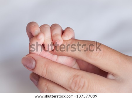 Mother's hand holding small hand  her baby #137577089