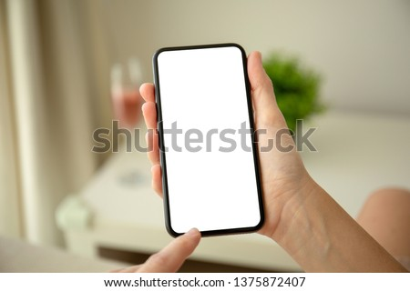 female hands holding phone with isolated screen in the house in room #1375872407