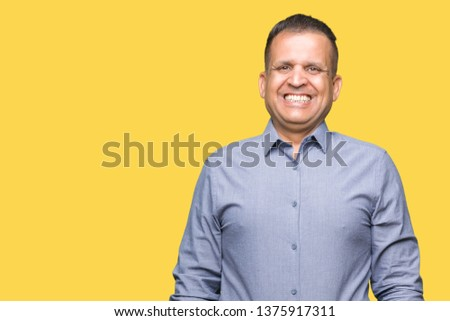 Middle age arab business man over isolated background with a happy and cool smile on face. Lucky person. #1375917311