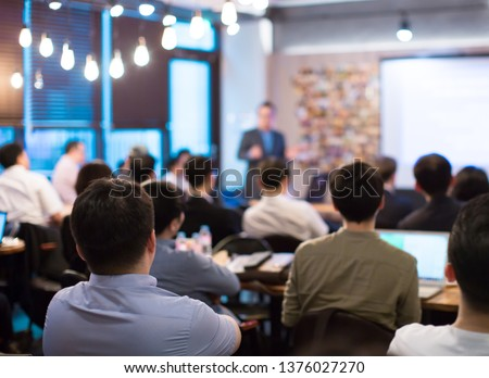 Seminar Presentation. Conference Speaker Presenting to Audience. Technology Presenter at Corporate Tech Leadership Forum. Executives, Entrepreneurs, Investors in Meeting. Lecture Speech by Manager.  Royalty-Free Stock Photo #1376027270
