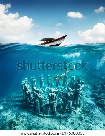 The girl is snorkeling near the famous place on Gili Meno Island, Indonesia. Underwater tourism in the ocean. Vacation and adventure. Gili Meno Island, Indonesia. Travel - image #1376088353