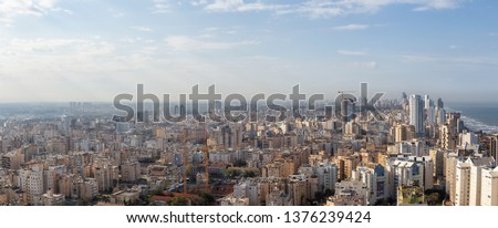 Aerial view of a residential neighborhood in a city during a cloudy and sunny sunrise. Taken in Netanya, Center District, Israel. #1376239424
