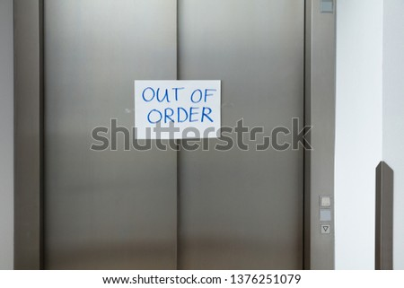 Written Text Out Of Order Message In White Paper On Closed Elevator Door