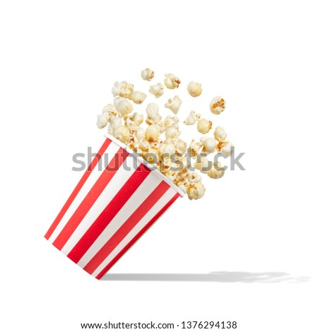 Popcorn in striped bucket isolated on white background #1376294138