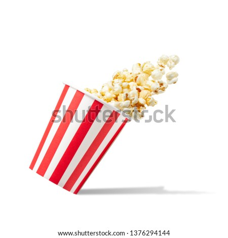 Popcorn in striped bucket isolated on white background #1376294144