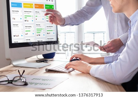 Colleagues working on agile product development board with scrum or kanban framework, lean methodology, iterative or incremental organization project management strategy for startup or software design #1376317913
