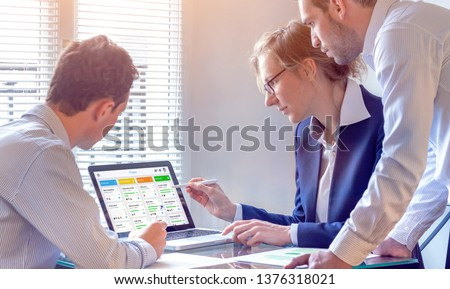 Daily team meeting around agile product development board with scrum or kanban framework, lean methodology, iterative or incremental organization project management strategy for software design #1376318021