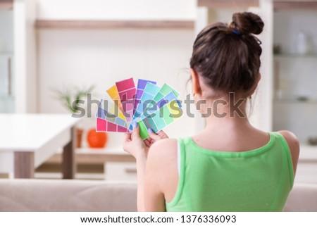 Young beautiful woman doing renovation at home  #1376336093