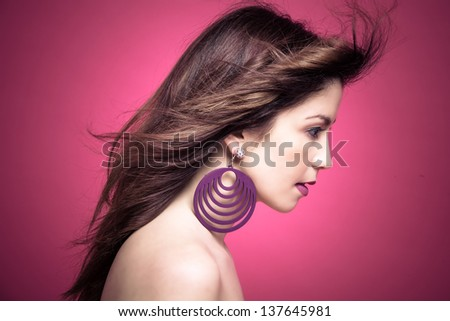 lovely brunette young woman profile with hair in motion #137645981