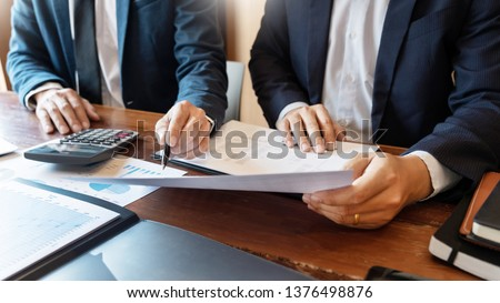 Business Corporate team brainstorming, Planning Strategy having a discussion Analysis investment researching with chart at office his desk documents and saving concept. #1376498876