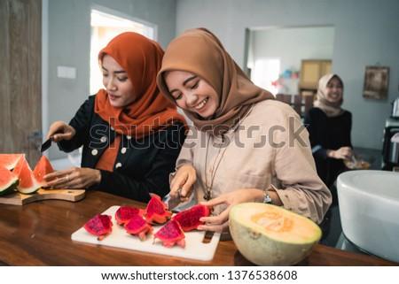 muslim woman friend preparing some fruit dessert cocktail for break fasting in the kitchen #1376538608