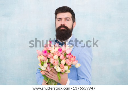 Flowers for her. Man bearded suit bow tie hold tulips bouquet. Gentleman making romantic surprise for her. Flowers delivery. Gentleman romantic date. Birthday greetings. Best flowers for girlfriend. #1376559947