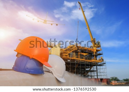 Safety helmet stacked Oil Refinery factory Sunrise in background The concept of safety cooperation in refineries. #1376592530