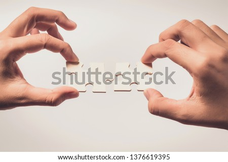 Pieces of jigsaw puzzle in woman's hands #1376619395