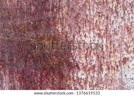 The old rusty surface of metal damaged by bad weather. Spots and smudges of paint. Ready photo background. Macro. #1376619533