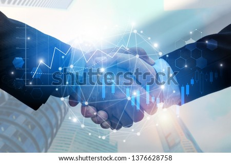 Partnership - business man handshake with effect global network connectionม graph chart stock market graphic diagram and city background, digital technology, internet communication, teamwork concept #1376628758