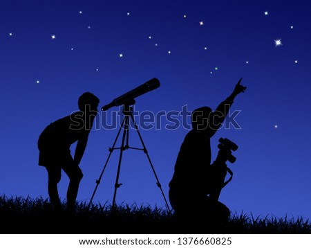 father and son study the starry sky through a telescope on the lawn #1376660825