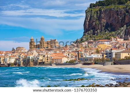 Cefalu is city in Italian Metropolitan City of Palermo located on Tyrrhenian coast of Sicily, Italy. Cefalu is popular travel destination in Italy because of long sandy beach and clear blue sea. #1376703350