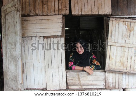 City of Pasuruan, East Java - Indonesia. Saturday, March 23, 2019. A portrait with a woman in an old house during the Pasuruan Jaman Biyen event #1376810219