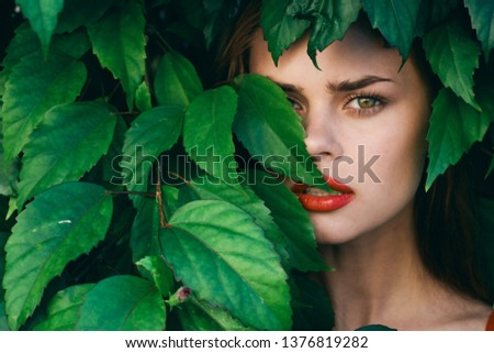 busheswoman green leaves spring park bright makeup                                #1376819282