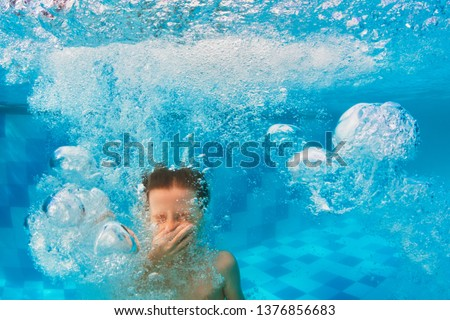 Happy family have fun in swimming pool. Funny child swim, dive in pool - jump deep down underwater from poolside. Healthy lifestyle, people water sport activity, swimming lessons on holidays with kids #1376856683