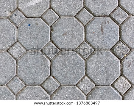 footpath tiles background - Top view of grey brick arranged in the same pattern  #1376883497