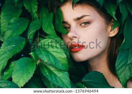 pretty woman with make up on face green shrub exotic nature #1376946494