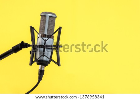 microphone isolated on Yellow background (Mic, condencer Mic, Voice Mic, Instrument Mic, Studio Mics, Microphones, condencer Microphone, Voice Microphone, Instrument Microphone, Studio Microphones) #1376958341