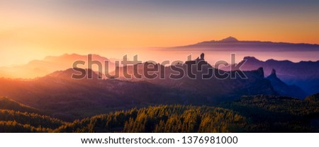 Sunset from the top of Gran Canaria Island. Pico de las Nieves. As main subject you can see the Roque nublo and the Teide in Tenerife Island. #1376981000